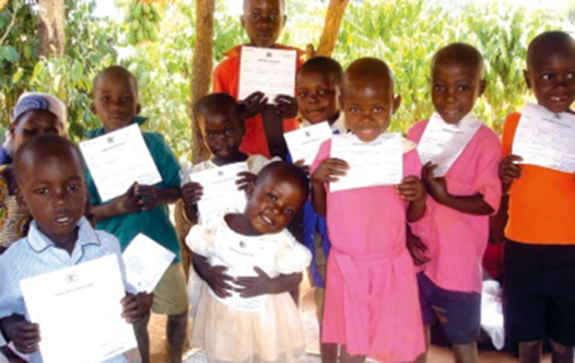 Ugandan children proudly show off their birth certificates
